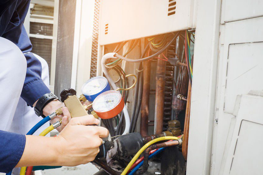 a technician works on residential heating in savannah