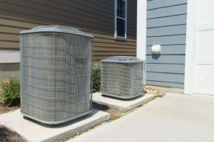 an air conditioner and heat pump outside of a home | residential hvac savannnah