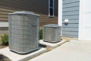 an air conditioner and heat pump outside of a home | residential hvac savannnah