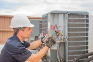 Service Emperor technician working on an emergency air conditioner repair in savannah