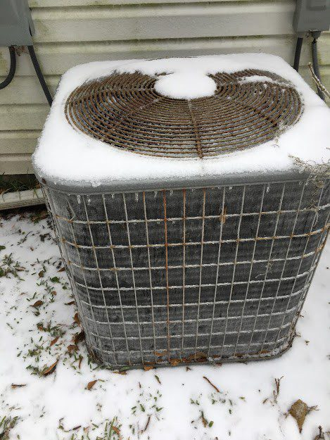 Snow covered outdoor unit