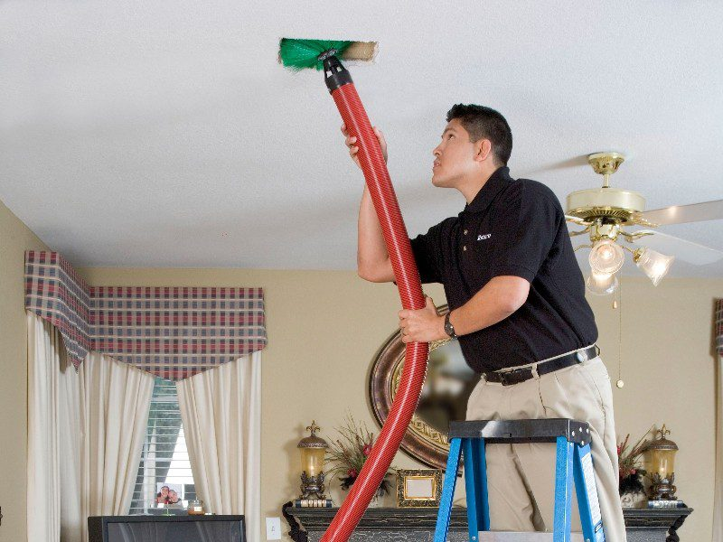 Service Emperor Tech cleaning ducts in a home