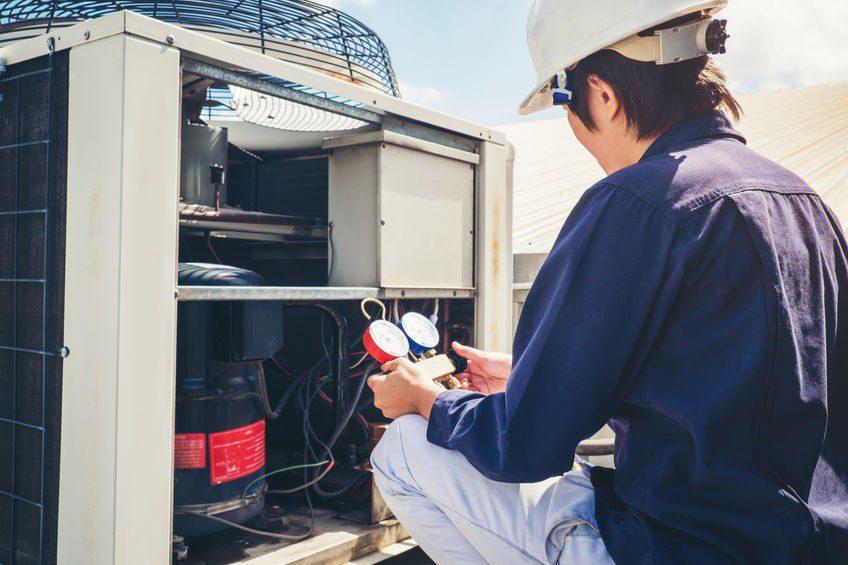 Service Emperor Technician is checking air conditioner in Savannah