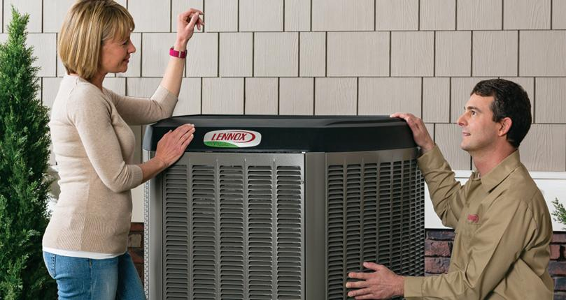 Service Emperor HVAC Technician discussing Heat pump installation with homeowner