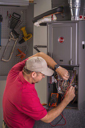 Service Emperor Tech repairing a furnace