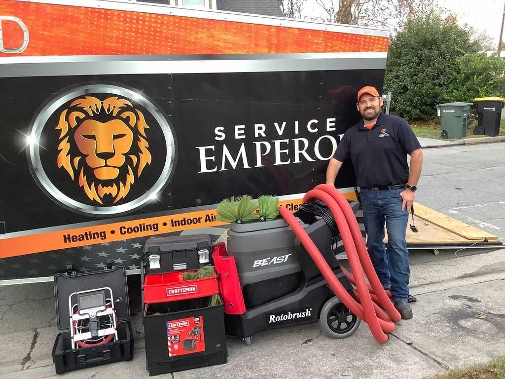 Duct Cleaner next to Service Emperor Trailer w Joshua