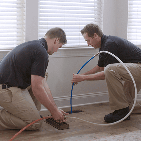 Service Emperor techs cleaning ducts in a home